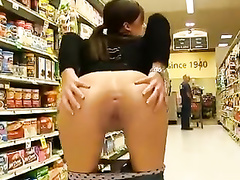 Petite chick decides to reveal her pussy in the supermarket