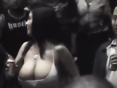 Dark-haired lady demonstrates her huge boobs in public places
