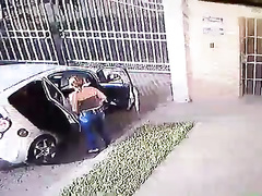 Suave girl takes a leak next to the car