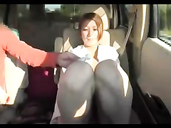 Japanese girl plays with her hairy pussy in the car