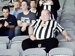 Fat football fan has his wiener revealed while watching a match
